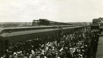 Red Deer Archives, P211; Passenger train filled with military men in Red Deer, 1915