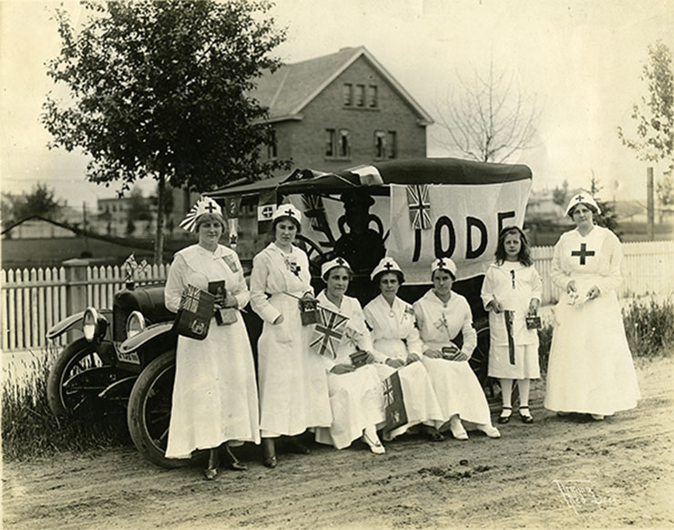 Red Deer Archives, P2129; Red Cross nurses with an IODE banner, 1916