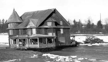 Cronquist House being moved across the Red Deer River to Bower Ponds in 1976