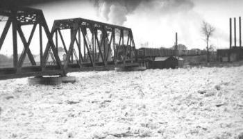 C.P.R Bridge with a train crossing it in the 1930s.