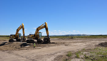 Photo of large diggers in a construction area