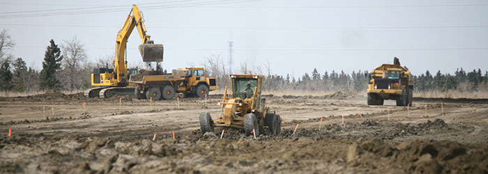 Heavy equipment developing land