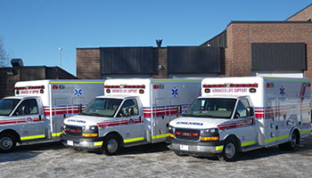 Three ambulances lines up outside fire station