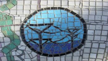 Glass mosaic tiles layed out to look like fish.
